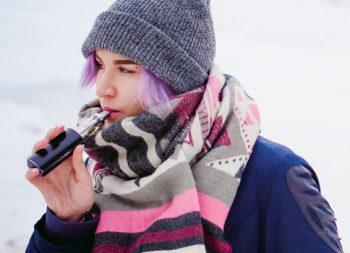 Young girl smoking an e-cigarette
